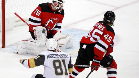 <p>               Vegas Golden Knights center Jonathan Marchessault (81) watches his shot on New Jersey Devils goaltender Mackenzie Blackwood (29) during the third period of an NHL hockey game, Tuesday, Dec. 3, 2019, in Newark, N.J. Marchessault scored three goals in the third period to help the Golden Knights defeat the Devils 4-3. New Jersey Devils defenseman Sami Vatanen (45) watches. (AP Photo/Kathy Willens)             </p>