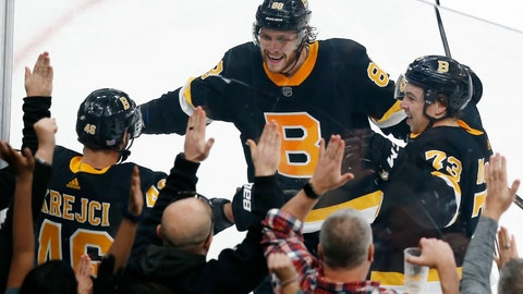 <p>               Boston Bruins' David Krejci (46) celebrates his winning goal with David Pastrnak (88) and Charlie McAvoy (73) in overtime during an NHL hockey game against the New York Rangers in Boston, Friday, Nov. 29, 2019. (AP Photo/Michael Dwyer)             </p>