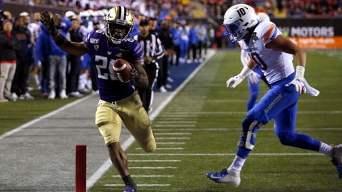 <p>               Washington running back Salvon Ahmed, left, makes it into the end zone ahead of Boise State safety Kekoa Nawahine for Washington's second touchdown during the first half of the Las Vegas Bowl NCAA college football game at Sam Boyd Stadium, Saturday, Dec. 21, 2019, in Las Vegas. (AP Photo/Steve Marcus)             </p>