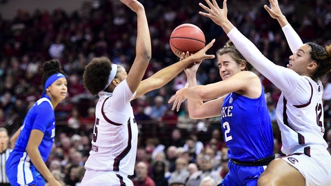 <p>               Duke guard Haley Gorecki (2) is defended by South Carolina's Breanna Beal (12) and Victaria Saxton (5) during the first half of an NCAA college basketball game Thursday, Dec. 19, 2019, in Columbia, S.C. (AP Photo/Sean Rayford)             </p>