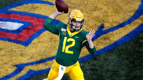 <p>               Baylor quarterback Charlie Brewer passes the ball during the first half of an NCAA college football game against Kansas, Saturday, Nov. 30, 2019, in Lawrence, Kan. (AP Photo/Charlie Riedel)             </p>