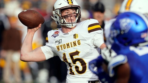 <p>               Wyoming quarterback Levi Williams (15) throws down field against Georgia State in the first half of the Arizona Bowl NCAA college football game, Tuesday, Dec. 31, 2019, in Tucson, Ariz. (AP Photo/Rick Scuteri)             </p>
