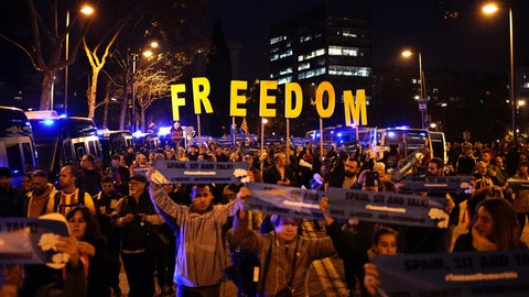 <p>               Catalan pro-independence demonstrators block a road as they protest outside the Camp Nou stadium ahead of a Spanish La Liga soccer match between Barcelona and Real Madrid in Barcelona, Spain, Wednesday, Dec. 18, 2019. Thousands of Catalan separatists are planning to protest around and inside Barcelona's Camp Nou Stadium during Wednesday's match against fierce rival Real Madrid. (AP Photo/Felipe Dana)             </p>