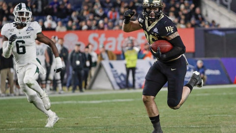 <p>               Wake Forest's Jack Freudenthal (86) runs away from Michigan State's David Dowell (6) for a touchdownduring the first half of the Pinstripe Bowl NCAA college football game Friday, Dec. 27, 2019, in New York. (AP Photo/Frank Franklin II)             </p>