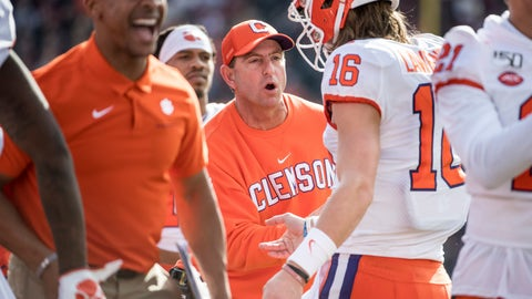 <p>               Clemson head coach Dabo Swinney greets Trevor Lawrence (16) after a touchdown against South Carolina during the first half of an NCAA college football game Saturday, Nov. 30, 2019, in Columbia, S.C. (AP Photo/Sean Rayford)             </p>