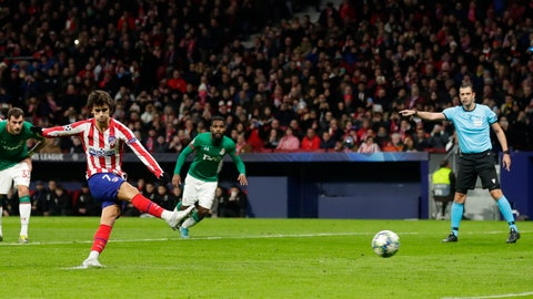 <p>               Atletico Madrid's Joao Felix scores a penalty kick during the Champions League Group D soccer match between Atletico Madrid and Lokomotiv Moscow at Wanda Metropolitano stadium in Madrid, Spain, Wednesday, Dec. 11, 2019. (AP Photo/Manu Fernandez)             </p>
