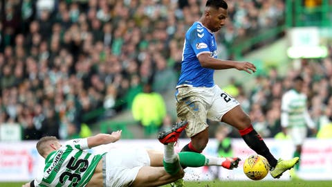 <p>               Celtic's Kristoffer Ajer, left and Rangers' Alfredo Morelos battle for the ball, during the Scottish Premiership soccer match between Celtic and Rangers at  Celtic Park, in Glasgow, Scotland, Sunday Dec. 29, 2019. The Scottish title race opened up further when Nikola Katic's header gave Rangers a 2-1 victory over leader Celtic in the derby between the Glasgow rivals.  (Andrew Milligan/PA via AP)             </p>