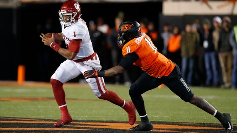 <p>               Oklahoma quarterback Jalen Hurts (1) is pursued by Oklahoma State linebacker Amen Ogbongbemiga (11) in the second half of an NCAA college football game in Stillwater, Okla., Saturday, Nov. 30, 2019. (AP Photo/Sue Ogrocki)             </p>