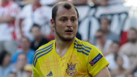 "<p>               FILE - In this Tuesday, June 21, 2016 file photo, Ukraine's Roman Zozulya protest to a referee during the Euro 2016 Group C soccer match between Ukraine and Poland at the Velodrome stadium in Marseille, France.  The Ukrainian player called ""a Nazi"" by fans in a Spanish second-division match suspended because of the insults had already been targeted by fans last season. The game between Rayo Vallecano and Albacete  on Sunday, Dec. 15, 2019 was halted at halftime after Rayo fans used abusive language against Zozulia in chants and a in a banner. (AP Photo/Ariel Schalit, File)             </p>"