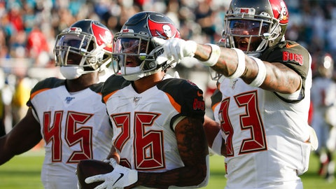 <p>               Tampa Bay Buccaneers defensive back Sean Murphy-Bunting (26) celebrates his interception against the Jacksonville Jaguars with linebacker Devin White (45) and cornerback Carlton Davis (33) during the second half of an NFL football game, Sunday, Dec. 1, 2019, in Jacksonville, Fla. (AP Photo/Stephen B. Morton)             </p>