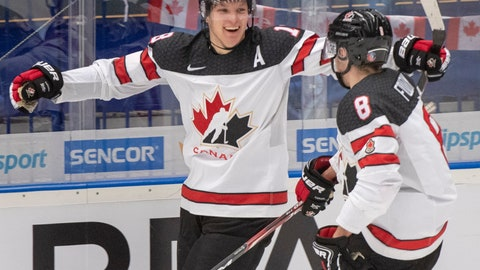 <p>               Canada's Ty Dellandrea celebrates with teammate Liam Foudy (8) after scoring the fourth goal against Germany during the third period at the World Junior Hockey Championships Monday, Dec. 30, 2019 in Ostrava, Czech Republic. (Ryan Remiorz/The Canadian Press via AP)             </p>