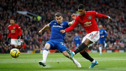 <p>               Manchester United's Marcus Rashford, right, has a shot on goal under pressure from Everton's Seamus Coleman during the English Premier League match between Manchester United and Everton at Old Trafford, Manchester, England, Sunday, Dec. 15, 2019. (Martin Rickett/PA via AP)             </p>