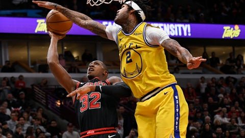 <p>               Chicago Bulls' Kris Dunn (32) goes up for a shot against Golden State Warriors' Willie Cauley-Stein (2) during the second half of an NBA basketball game Friday, Dec. 6, 2019, in Chicago. Golden State won 100-98. (AP Photo/Paul Beaty)             </p>