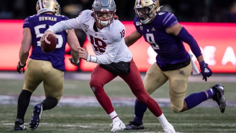 <p>               Washington State quarterback Anthony Gordon scrambles out of the pocket as he is chased by Washington linebacker Joe Tryon during the second half of an NCAA college football game, on Friday, Nov. 29, 2019 in Seattle. Washington won 31-13. (AP Photo/Stephen Brashear)             </p>