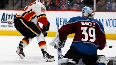 <p>               The winning goal shot by Calgary Flames center Sean Monahan, left, flies past Colorado Avalanche goaltender Pavel Francouz into the net in overtime of an NHL hockey game Monday, Dec. 9, 2019, in Denver. The Flames won 5-4 in overtime. (AP Photo/David Zalubowski)             </p>