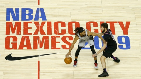 <p>               San Antonio Spurs' Patty Mills dribbles that ball as Phoenix Suns' Tyler Johnson defends in the first half of their regular-season NBA basketball game in Mexico City, Saturday, Dec. 14, 2019. (AP Photo/Rebecca Blackwell)             </p>