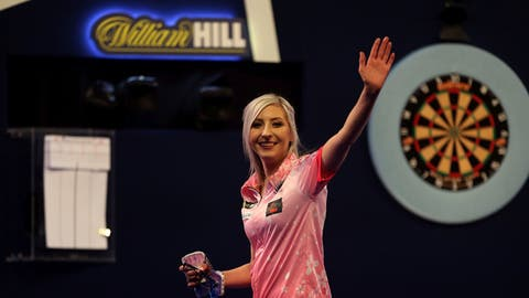 <p>               Fallon Sherrock celebrating after becoming the first women to win a game in the PDC Darts World Championship at Alexandra Palace, London, Tuesday Dec. 17, 2019. Sherrock become the first female player to beat a man at the PDC World Championship after she recovered from losing the opening set to beat Ted Evetts 3-2 in front of a raucous crowd at Alexandra Palace. (Steven Paston/PA via AP)             </p>
