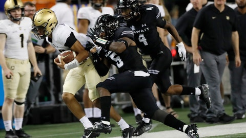 <p>               Army quarterback Christian Anderson (13) gets shoved out of bounds by Hawaii defensive back Khoury Bethley (5) during the second half of an NCAA college football game Saturday, Nov. 30, 2019 in Honolulu. (AP Photo/Marco Garcia)             </p>