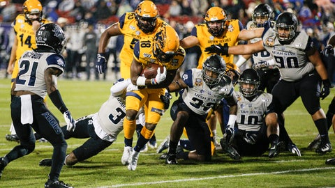 <p>               Kent State running back Xavier Williams (18) scores a touchdown as Utah State safety Troy Lefeged Jr. (3) defends during the first half of the Frisco Bowl NCAA college football game Friday, Dec. 20, 2019, in Frisco, Texas. (AP Photo/Brandon Wade)             </p>