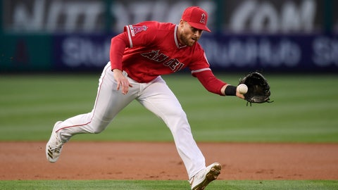 <p>               FILE - In this Saturday, May 25, 2019, file photo, Los Angeles Angels third baseman Zack Cozart fields a ball hit by Texas Rangers' Shin-Soo Choo, throwing him out at first, during the first inning of a baseball game in Anaheim, Calif. The San Francisco Giants bolstered their infield Tuesday, Dec. 10, 2019, by acquiring Cozart and prospect Will Wilson from the Los Angeles Angels for a player to be named or cash. (AP Photo/Mark J. Terrill, File)             </p>