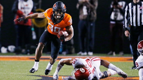 <p>               Oklahoma State running back Chuba Hubbard (30) avoids a tackle by Oklahoma linebacker Caleb Kelly (19) in the first half of an NCAA college football game in Stillwater, Okla., Saturday, Nov. 30, 2019. (AP Photo/Sue Ogrocki)             </p>