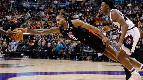 <p>               Los Angeles Clippers forward Kawhi Leonard (2) stretches for the ball as Toronto Raptors forward OG Anunoby (3) looks on during the second half of an NBA basketball game, Wednesday, Dec. 11, 2019, in Toronto. (Nathan Denette/The Canadian Press via AP)             </p>