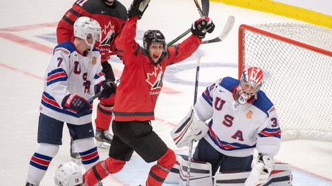<p>               Canada's Dylan Cozens, centre, and teammate Alexis Lafreniere (11) react after the third goal on the United States goaltender Spencer Knight as teammates Spencer Stastney(7) and K'Andre Miller(19) look on during second period at the World Junior Hockey Championships in Ostrava, Czech Republic, Thursday, Dec. 26, 2019. (Ryan Remiorz/The Canadian Press via AP)             </p>