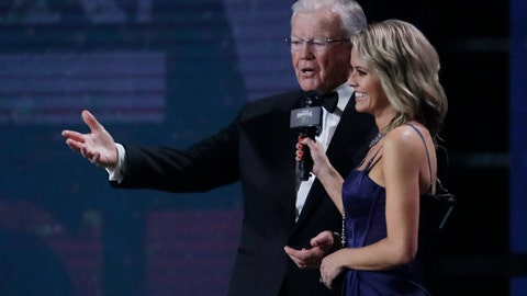 <p>               Team owner Joe Gibbs, left, speaks after being given the Bill France Award of Excellence at the NASCAR Cup Series Awards on Thursday, Dec. 5, 2019, in Nashville, Tenn. (AP Photo/Mark Humphrey)             </p>