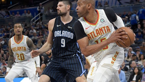 <p>               Atlanta Hawks guard Vince Carter (15) grabs a rebound near teammate John Collins (20) and Orlando Magic center Nikola Vucevic (9) during the first half of an NBA basketball game Monday, Dec. 30, 2019, in Orlando, Fla. (AP Photo/Phelan M. Ebenhack)             </p>