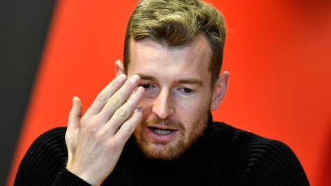<p>               Leverkusen's goalkeeper Lukas Hradecky talks during an interview with the Associated Press at the BayArena in Leverkusen, Germany, Monday, Dec. 2, 2019. Bayer Leverkusen keeper Lukas Hradecky dislodged a contact lens while playing against the German champions Bayern on Saturday, but he still helped Leverkusen to a surprise win. (AP Photo/Martin Meissner)             </p>