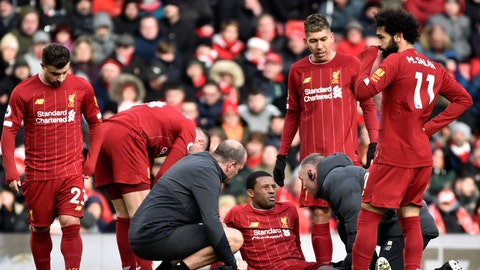 <p>               Liverpool's Georginio Wijnaldum is treated for injury during the English Premier League soccer match between Liverpool and Watford at Anfield stadium in Liverpool, England, Saturday, Dec. 14, 2019. (AP Photo/Rui Vieira)             </p>