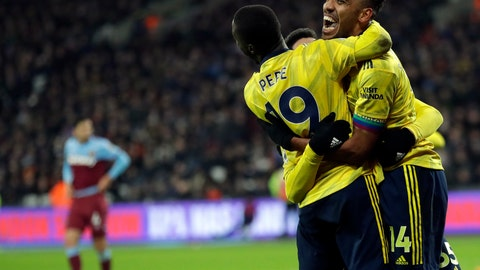 <p>               Arsenal's Pierre-Emerick Aubameyang, right, celebrates with teammates after scoring his side's third goal duels for the ball with during the English Premier League soccer match between West Ham Utd and Arsenal at the London Stadium in London, Monday, Dec. 9, 2019. (AP Photo/Kirsty Wigglesworth)             </p>