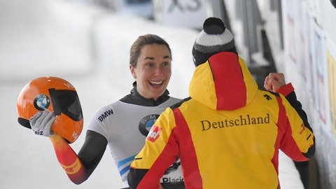 <p>               Jacqueline Loelling, of Germany, celebrates her first place finish after the second run of the women's World Cup skeleton opener in Lake Placid, N.Y., on Saturday, Dec. 7, 2019. (AP Photo/Hans Pennink)             </p>