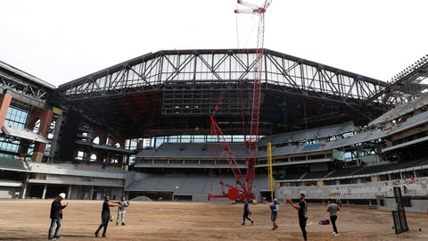 <p>               Texas Rangers players warm up during a tour of the under construction baseball field at the new Rangers stadium in Arlington, Texas, Wednesday, Dec. 4, 2019. (AP Photo/LM Otero)             </p>