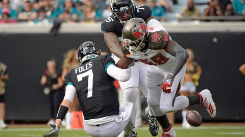<p>               Jacksonville Jaguars quarterback Nick Foles (7) fumbles the ball as he is hit by Tampa Bay Buccaneers linebacker Shaquil Barrett (58) during the first half of an NFL football game, Sunday, Dec. 1, 2019, in Jacksonville, Fla. (AP Photo/Phelan M. Ebenhack)             </p>