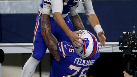 <p>               Buffalo Bills' Josh Allen (17) is lifted up by guard Jon Feliciano (76) after Allen ran the ball for a touchdown in the second half of an NFL football game against the Dallas Cowboys in Arlington, Texas, Thursday, Nov. 28, 2019. (AP Photo/Michael Ainsworth)             </p>