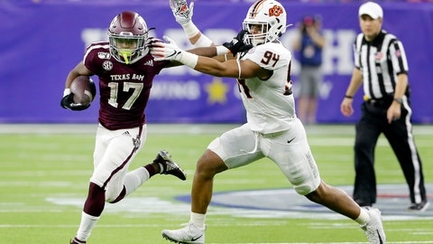 <p>               Texas A&M wide receiver Ainias Smith (17) fends off Oklahoma State defensive end Trace Ford (94) during the first half of the Texas Bowl NCAA college football game Friday, Dec. 27, 2019, in Houston. (AP Photo/Michael Wyke)             </p>