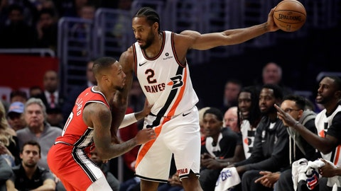 <p>               Portland Trail Blazers' Damian Lillard, left, defends on Los Angeles Clippers' Kawhi Leonard (2) during the first half of an NBA basketball game Tuesday, Dec. 3, 2019, in Los Angeles. (AP Photo/Marcio Jose Sanchez)             </p>