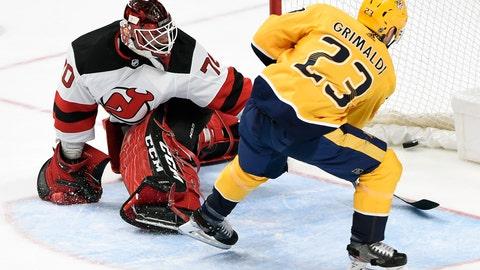 <p>               Nashville Predators right wing Rocco Grimaldi (23) scores against New Jersey Devils goaltender Louis Domingue (70) during the third period of an NHL hockey game Saturday, Dec. 7, 2019, in Nashville, Tenn. The Predators won 6-4. (AP Photo/Mark Zaleski)             </p>