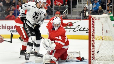 <p>               Los Angeles Kings center Anze Kopitar, left, of Slovenia, scores a goal past Detroit Red Wings goaltender Eric Comrie in the second period of an NHL hockey game Sunday, Dec. 15, 2019, in Detroit. (AP Photo/Jose Juarez)             </p>