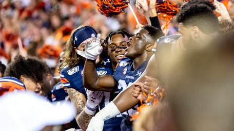 <p>               Auburn players sit in the student section as fans take the field to celebrate an upset of Alabama after an NCAA college football game, Saturday, Nov. 30, 2019, in Auburn, Ala. (AP Photo/Vasha Hunt)             </p>