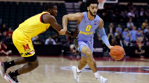 <p>               Marquette guard Markus Howard (0) is fouled by Maryland guard Darryl Morsell, left, during the first half of an NCAA college basketball game Sunday, Dec. 1, 2019, in Lake Buena Vista, Fla. (AP Photo/Scott Audette)             </p>