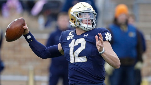 <p>               Notre Dame quarterback Ian Book (12) throws against Boston College during the first half of an NCAA college football game in South Bend, Ind., Saturday, Nov. 23, 2019. (AP Photo/Michael Conroy)             </p>