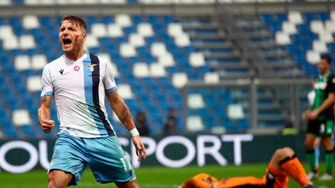 <p>               Lazio's Ciro Immobile shouts in celebration after scoring his side's opening goal during the Italian Serie A soccer match at the Mapei Stadium in Reggio Emilia, Italy, Sunday, Nov. 24, 2019. (Serena Campanini/ANSA via AP)             </p>