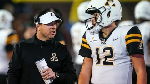<p>               Appalachian State coach Eliah Drinkwitz talks with quarterback Zac Thomas (12) during the second half of the team's NCAA college football game against Troy on Friday, Nov. 29, 2019, in Troy, Ala. (AP Photo/Butch Dill)             </p>