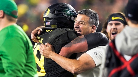 <p>               FILE - In this Dec. 6, 2018, file photo, Oregon coach Mario Cristobal, right, celebrates with offensive lineman Shane Lemieux (68) after Oregon defeated Utah 37-15 in an NCAA college football game for the Pac-12 Conference championship, in Santa Clara, Calif. Cristobal was named The Associated Press Pac-12 Coach of the Year Thursday, Dec. 12, 2019. (AP Photo/Tony Avelar, File)             </p>