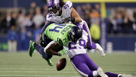 <p>               Seattle Seahawks' DK Metcalf (14) fumbles while being hit by Minnesota Vikings' Xavier Rhodes (29) and Eric Kendricks (54) during the second half of an NFL football game, Monday, Dec. 2, 2019, in Seattle. The Vikings' recovered on the play. (AP Photo/John Froschauer)             </p>