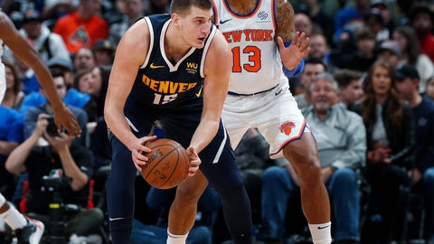 <p>               Denver Nuggets center Nikola Jokic, left, looks to pass the ball as New York Knicks forward Marcus Morris Sr. defends in the first half of an NBA basketball game Sunday, Dec. 15, 2019, in Denver. (AP Photo/David Zalubowski)             </p>