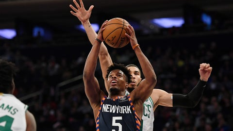 <p>               New York Knicks guard Dennis Smith Jr. (5) attempts a basket during the first half of an NBA basketball game against the Boston Celtics, Sunday, Dec. 1, 2019, in New York. (AP Photo/Sarah Stier)             </p>