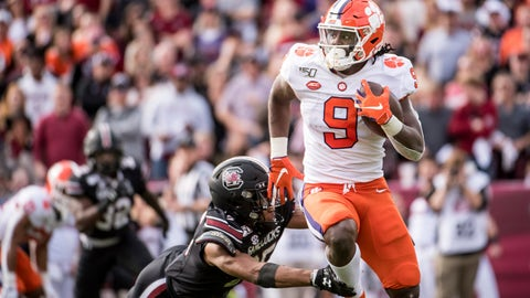 <p>               Clemson running back Travis Etienne (9) carries the ball against South Carolina's A.J. Turner during the first half of an NCAA college football game Saturday, Nov. 30, 2019, in Columbia, S.C. (AP Photo/Sean Rayford)             </p>